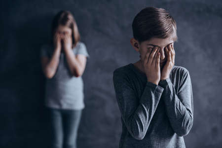 Frightened children being victims of domestic violence