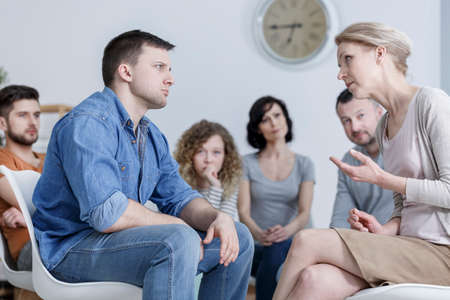 Man and woman having a discussion in caucasian support group