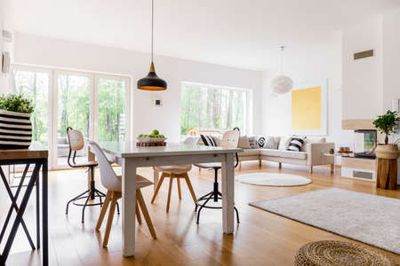 Monochromatic Striped Carpet On Wooden Floor In Cozy Living Room ...
