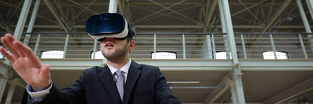 Modern architect with VR headset working in industrial interior, panorama Stock Photo - 85610474