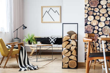Cozy winter interior design for minimalist with wooden accessories, warm colors and fire logs 版權商用圖片