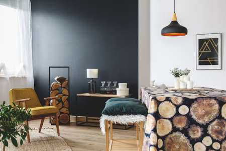 Rustic home decoration idea for cozy apartment with black wall and wood log table cover