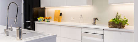 sink: Panorama of functional kitchen room with built-in cabinets and island in modern villa