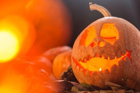 Glowing scary pumpkin lantern on a dark background