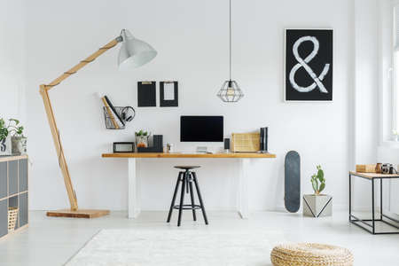 Minimalist black and white hipster room with poster and skateboard