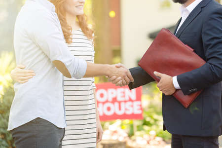 Close-up of real estate advisor congratulating young clients for buying a new home Stock fotó