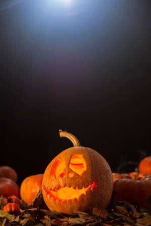 DIY Halloween decoration from pumpkin on a dark background Stock Photo