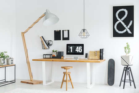 white minimalist studio with wooden desk space and accessories stock