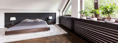 Inspiring Heater Cover In Bright Attic Bedroom Interior Stock Photo    87277517