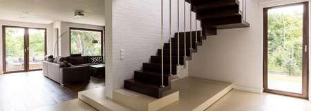 White brick wall in wooden minimalist modern staircase Stock Photo
