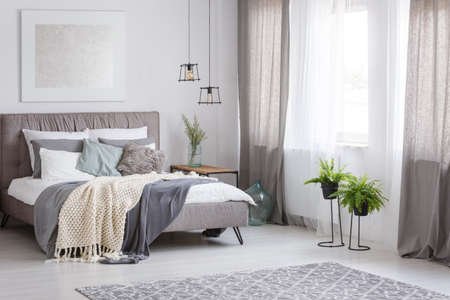 king fern: Grey bedding and mint pillow on king-size bed in sophisticated soft color bedroom with fern