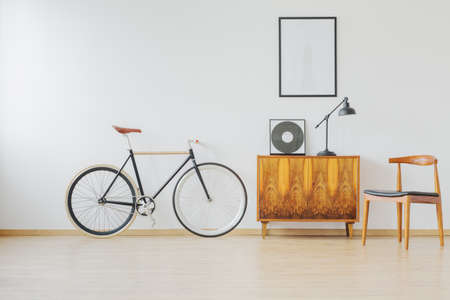Modern and stylish vintage apartment for hipster student with bike and wooden retro furniture Stock Photo - 89250080