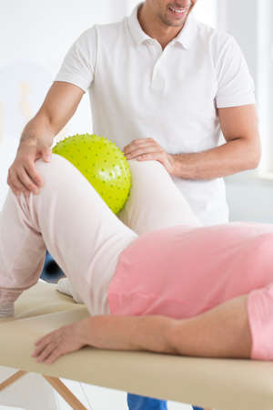 Patient having a pnf rehabilitation session at a physiotherapist private office