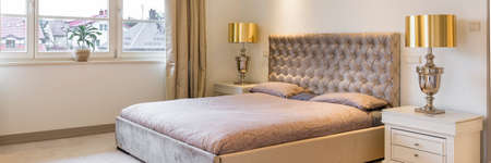 Elegant calm master bedroom with comfortable double bed