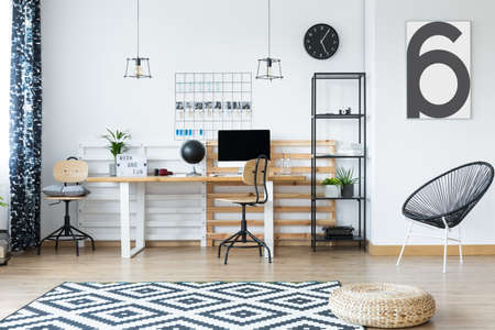 Genial Braided Pouf On Clock And White Carpet In Hygge Style Home Office With  Designed Chair Stock