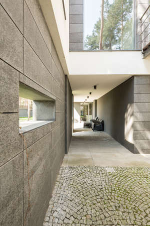 Minimalistic housefron of a house with a window and stone path