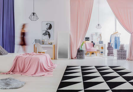 Triangle carpet in womans bedroom interior with pink curtains in entrance to dressing room