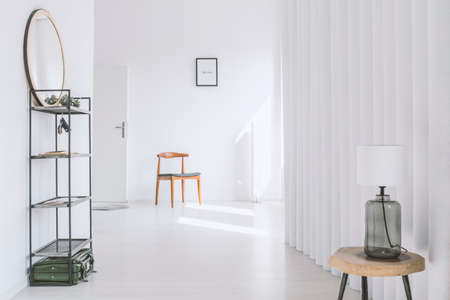 Vintage wooden chair near the entrance to a simple flat with minimalist design