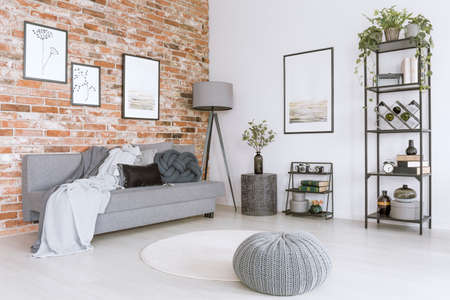Stock Photo   White And Gray Living Room With Knit Pouf, Round Rug And  Modern, Metal Lamp