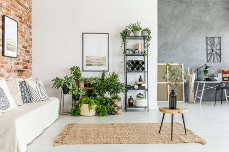 Open space living room on brick wall with  plants and modern study space Stock Photo - 88436486