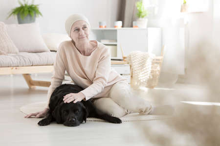 Cancer patient undergoing innovative pet therapy at home Stock Photo