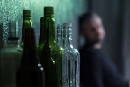 Empty glass bottles of wine and beer. Alcohol problem concept Standard-Bild
