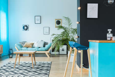Loft design in shades of blue with lounge area Standard-Bild - 97990970