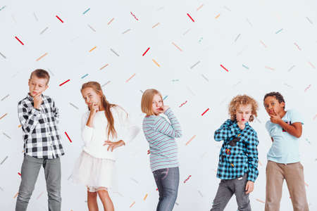 Children posing as thinkers by holding their hands to their chins