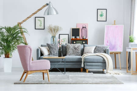 Designer pastel flat with painting on easel and velour carpet