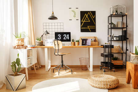 Braided Pouf On White Carpet In Stylish Home Office With Cacti On Desk And  Black Artwork