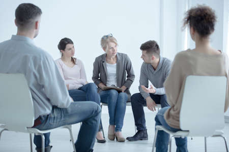 Man talking to a psychotherapist about family problems during meeting with support group