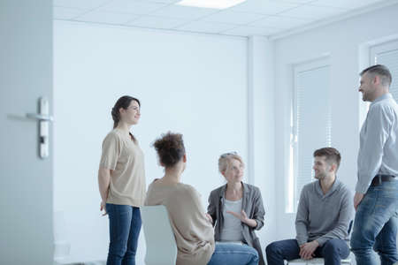 Mediator trying to reconcile two young people who are married at a couples meeting Stock Photo