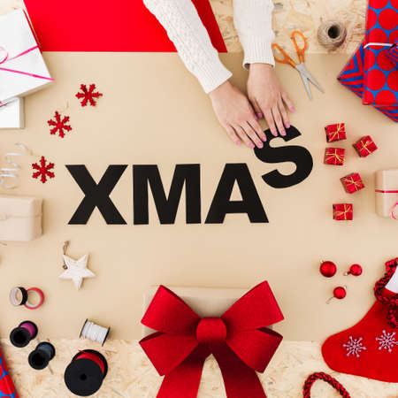 Funny xmas word build with black paper on table Banco de Imagens
