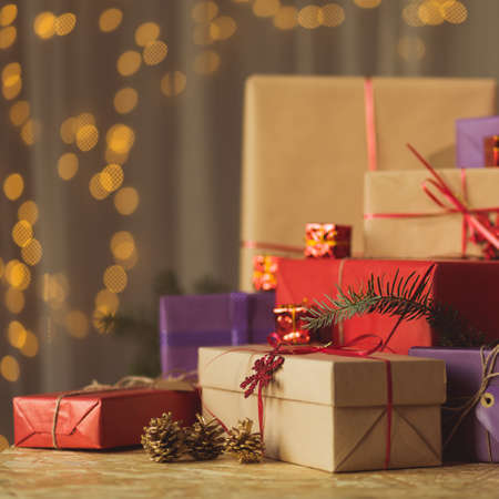 Pile of Christmas gifts wrapped in ecological paper