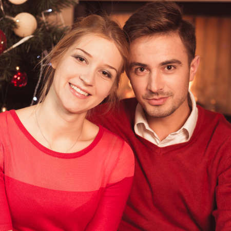 Image of married couple under christmas tree celebrating xmas Stock Photo
