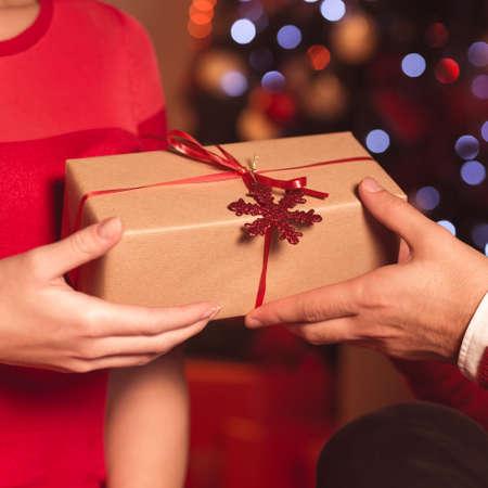 Close up of husband giving xmas present to wife Lizenzfreie Bilder