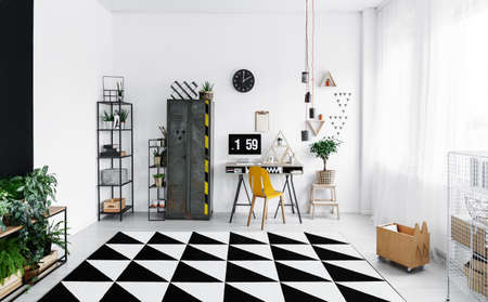 White modern industrial interior with fresh plants, carpet, locker and desk with computer Stockfoto - 97989941