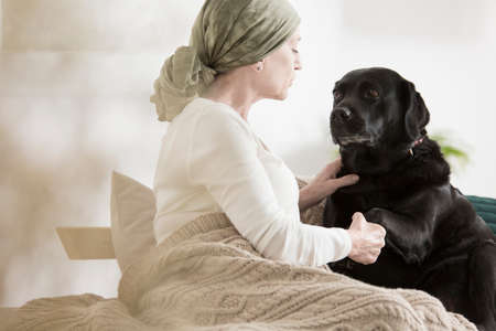 Cancer patient overcoming pain with pet assisted therapy treatment