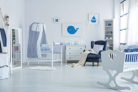 White crib with canopy for newborn baby standing in marine simple room