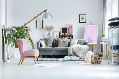 cozy living room with pink accents fur blanket and decorative