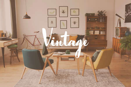 Filter of vintage living room with armchairs at wooden table on carpet and sideboard against a wall with posters