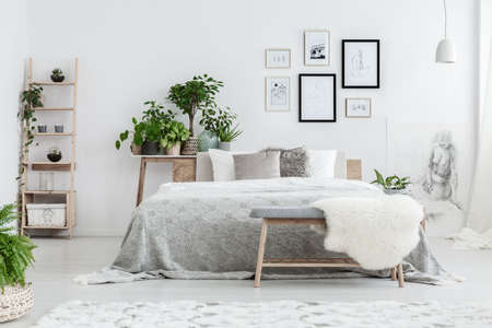 Handmade Drawings In Frames Hanging On The Wall In White Bedroom ...