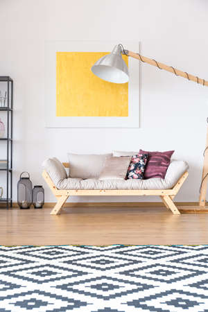 Merveilleux Large, Square Patterned Carpet Lying In Front Of A Cozy Sofa Standing  Underneath A Yellow
