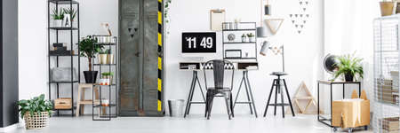 Industrial interior of freelancers office with metal locker, computer and modern desk Stock Photo