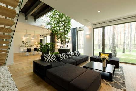 Spacious and elegant modern living room with comfortable sofa and big window
