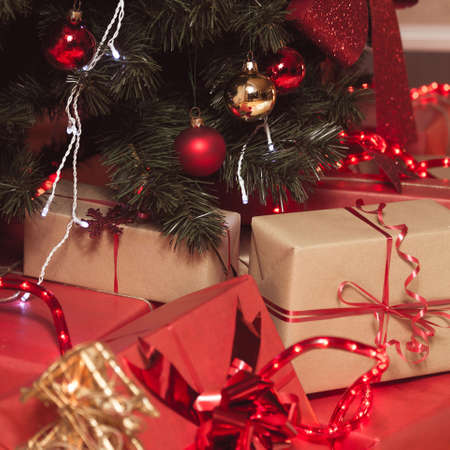 Wrapped gift boxes under decorated Christmas tree