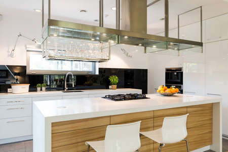 Sophisticated kitchen with a large kitchen worktop and kitchen island Stok Fotoğraf