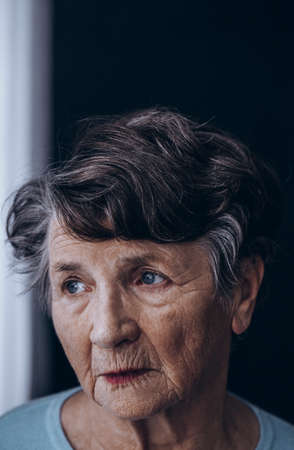 Close-up of old grandmothers face with wrinkles, lonely at home Stock fotó