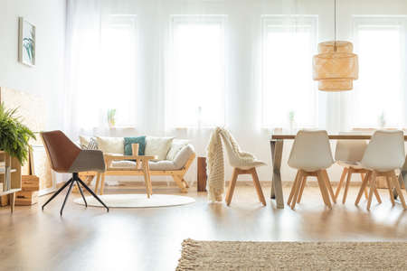 Attrayant Stock Photo   Vintage Chair And Sofa In Multifunctional Dining Room With  Wooden Table Under Lamp