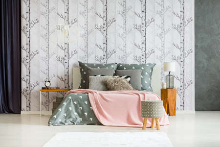 Spacious Bright Bedroom With Stools And Pink Blanket On King Size Bed  Against Forest Wallpaper